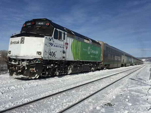 Winter Park Express engine painted in Century Link colors and logo